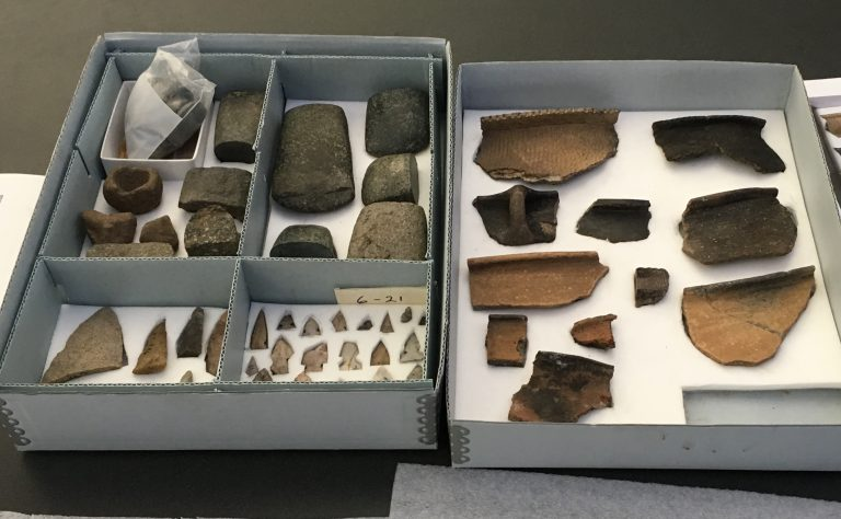 Curated archaeological artifacts (stone tools and pottery)