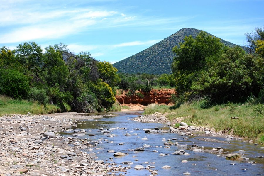 South African landscape with river in foreground and mountain in background