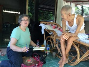 Katherine Bowie Interviewing Monk in Thailand