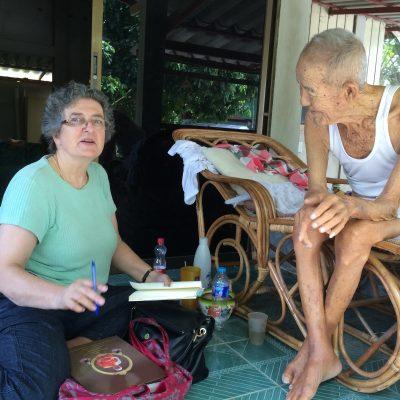 Katherine Bowie Interviewing Monk in Thailand