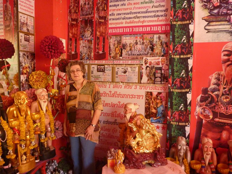 Katherine Bowie in Bangkok surrounded by images of the beggar Vessantara Jataka