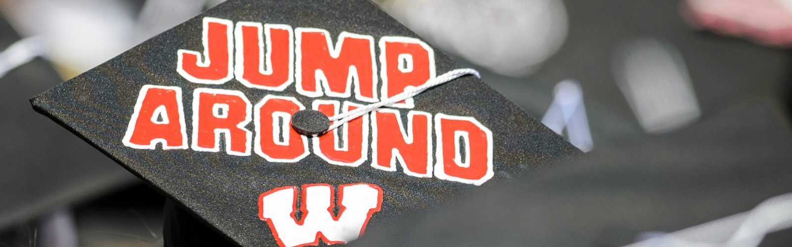 Commencement at Camp Randall with decorated mortar board